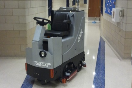 Cleaning a vinyl floor with a TomCat scrubber drier