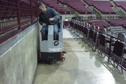 Cleaning concrete floors in a sports stadium
