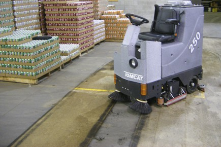 Concrete floor cleaning with a ride-on scrubber drier