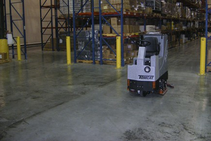 Hire a ride-on scrubber dryer for warehouse floor cleaning.