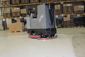 Refurbishing a painted floor with a ride-on scrubber drier using diamond pads