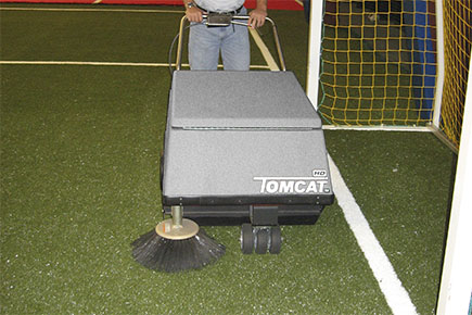 Sweeping artificial turf