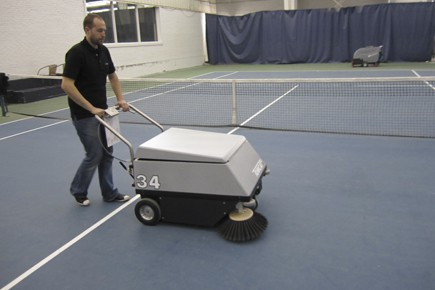 Sweeping a tennis court