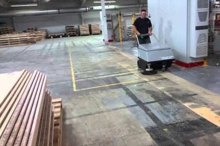 Dust Free Sweeping a warehouse floor with a FactoryCat Model 34