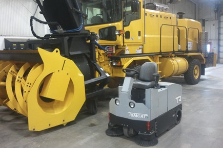 Compact industrial floor sweeper